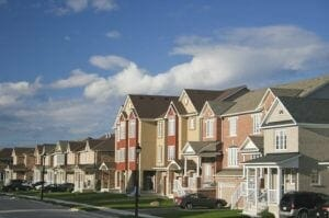 Picture of different color houses on a residential street.