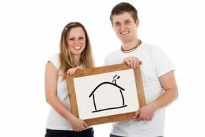 couple holding picture of a house